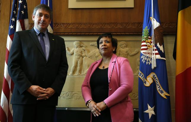 U.S. Attorney General Loretta Lynch (R) welcomes Belgian Deputy Prime Minister and Minister of Security and Interior Jan Jambon at the Justice Department in Washington March 31, 2016.   REUTERS/Gary Cameron
