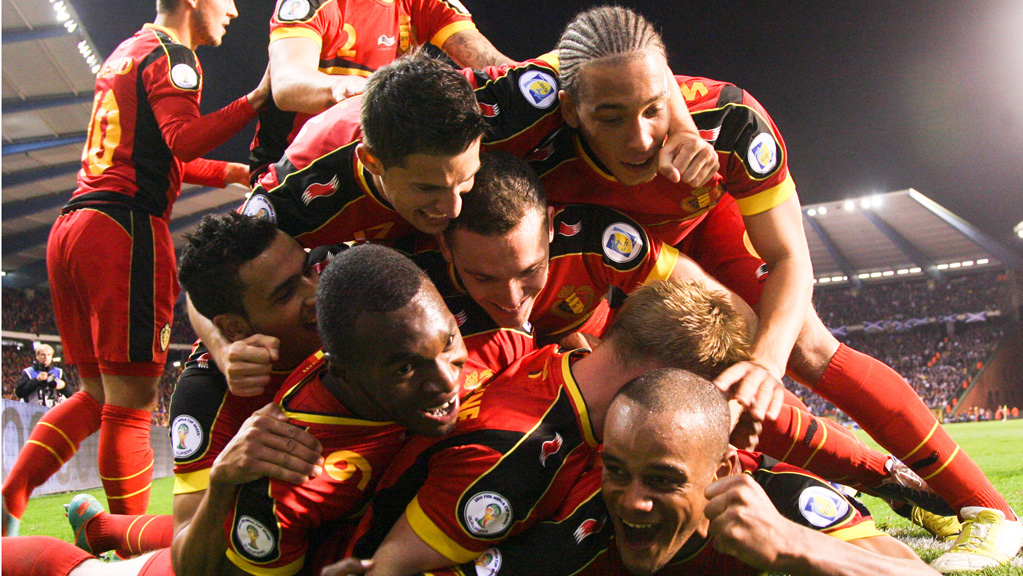 Belgium's Vincent Kompany (bottom) celebrates with teammates after scoring the 2-0 goal during the 2014 World Cup qualifying football match between Belgium and Scotland at the King Baudouin stadium in Brussels, on October 16, 2012. AFP PHOTO / BELGA / VIRGINIE LEFOUR  *** Belgium Out ***        (Photo credit should read VIRGINIE LEFOUR/AFP/Getty Images)
