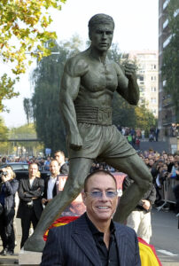 Actor Van Damme smiles during a ceremony unveiling a life-size statue of himself in Brussels